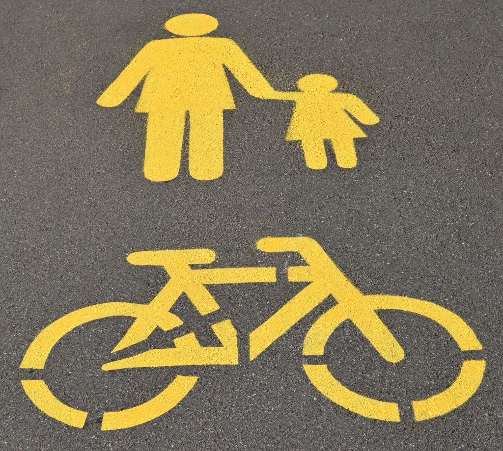 Pedestrian and bicycle road signs on the street